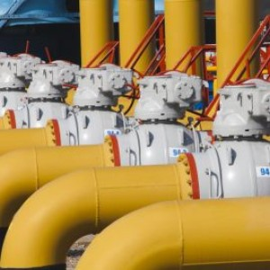 Pipes and valves are on the gas compressor station